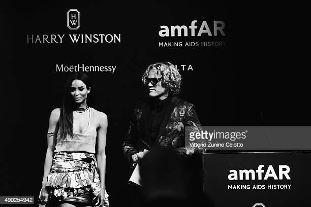 An alternative view of Ciara and Peter Dundas at amfAR Milano 2015 at La Permanente on September 26 2015 in Milan Italy