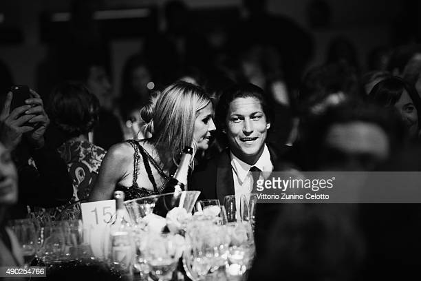 An alternative view of Heidi Klum and Vito Schnabel at amfAR Milano 2015 at La Permanente on September 26 2015 in Milan Italy
