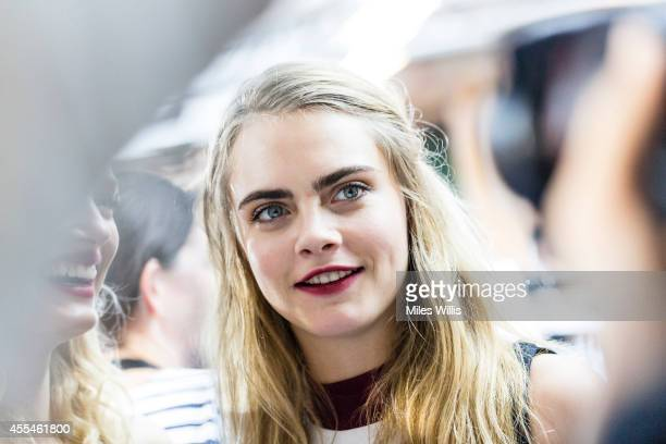 An alternative view of model Cara Delevingne backstage at the TopShop Unique show during London Fashion Week Spring Summer 2015 at on September 14...