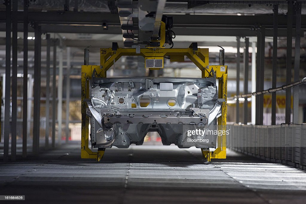 An aluminum section of an SUV automobile is transported along an automated section of the production line at Jaguar Land Rover Plc's assembly plant, a unit of Tata Motors Ltd., in Halewood, U.K., on Wednesday, Feb. 13, 2013. Carmakers from Ford Motor Co. to Audi AG and Jaguar Land Rover Plc are using record amounts of aluminium to replace heavier steel, providing relief to producers of the metal confronting excess supplies and depressed prices. Photographer: Simon Dawson/Bloomberg via Getty Images