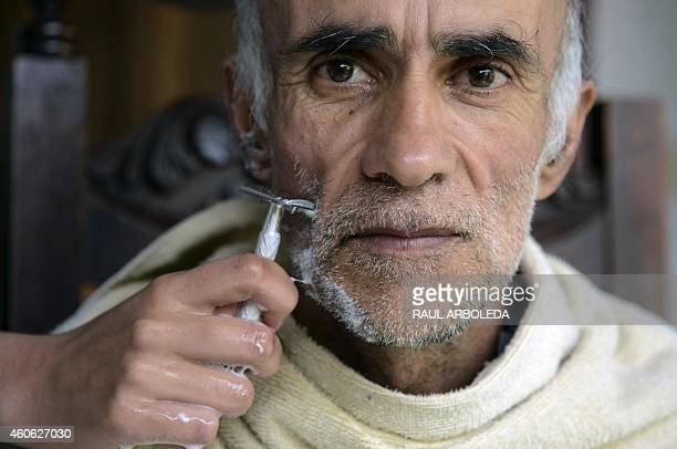 An Alzheimer's patient is shaved by his daughter at his house in Yarumal north of Antioquia department Colombia on December 3 2014 Yarumal holds one...