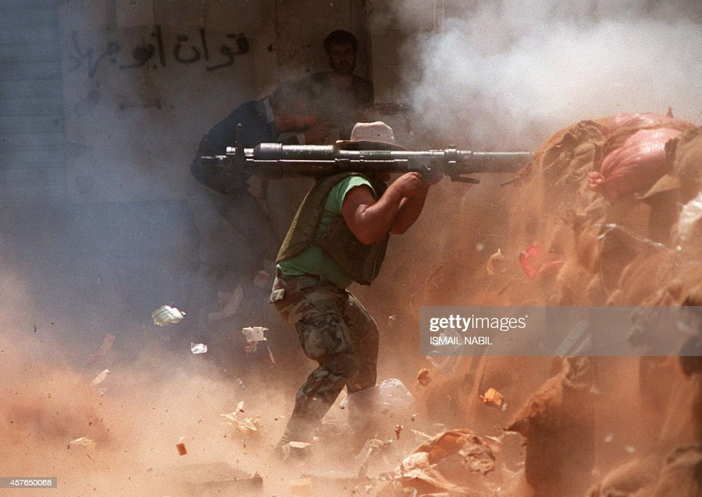An Amal militiaman armed with a B10 soviet made rocket propelled grenade shots the Palestinian positions in Chatila refugee camp 04 June1986 AFP...
