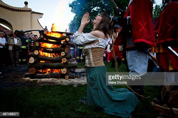 An amateur actor dressed as a witch reenacts a tale about witches burning during festivities on Walpurgis night in Kampa park on April 30 2013 in...