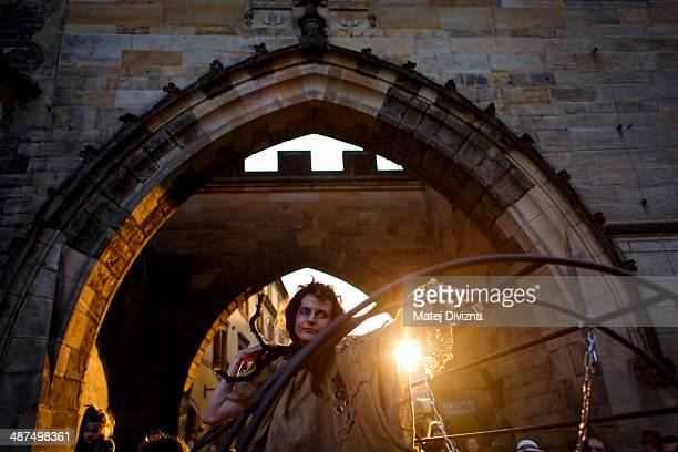 An amateur actor dressed as an imprisoned witch attends festivities on Walpurgis night in Kampa park on April 30 2013 in Prague Czech Republic...