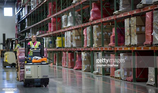 An Amazon Associate drives a forklift past shelves at an Amazon Fulfillment Center on February 13 2015 in DuPont Washington The eighth generation...