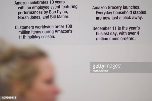An Amazon employee walks past a company timeline in the lobby of the Amazon Fulfillment Center on August 2 2017 in Robbinsville New Jersey The...