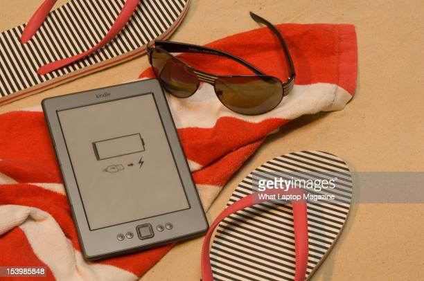 An Amazon Kindle shot in a beach scenario during a holiday technology feature February 6 2012