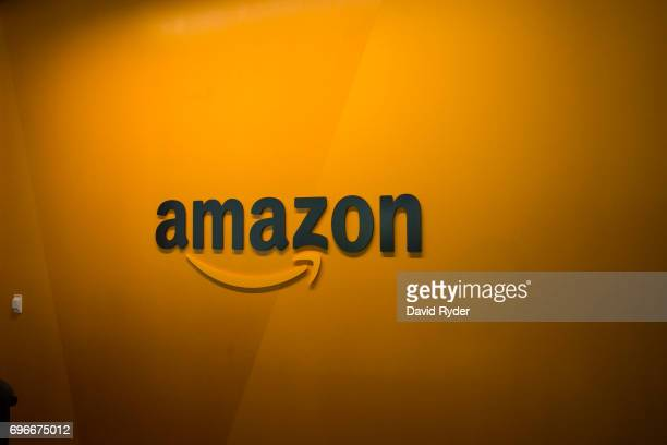 An Amazon logo is seen inside the Amazon corporate headquarters on June 16 2017 in Seattle Washington Amazon announced that it will buy Whole Foods...
