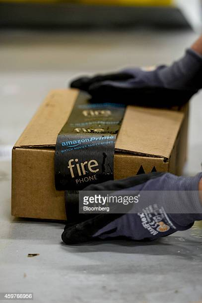 An Amazoncom Inc employee tapes a box at the company fulfillment center ahead of Cyber Monday in Tracy California US on Sunday Nov 30 2014 In 2005...