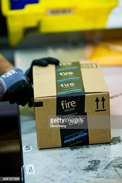 An Amazoncom Inc employee tapes a box at the company's fulfillment center ahead of Cyber Monday in Tracy California US on Sundayat the company's...