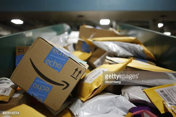 An Amazoncom Inc package is seen on a conveyor belt with other small parcels at the United States Postal Service sorting center in Louisville...