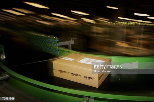 An Amazoncouk parcel passes along a conveyor belt in their facility on November 17 2006 in Milton Keynes England The online retailer is gearing up...