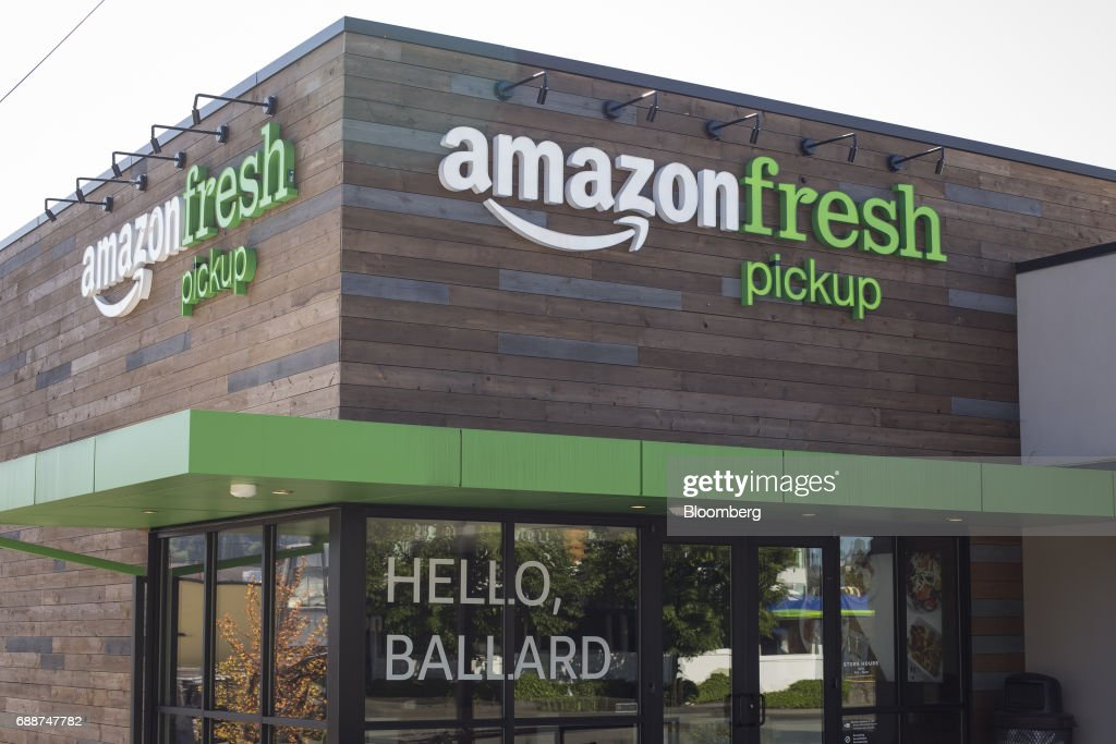 An AmazonFresh Pickup location stands in Seattle, Washington, U.S., on Friday, May 26, 2017. Amazon.com Inc. opened two grocery pickup kiosks in Seattle, part of its latest effort to enter the $800 billion grocery market and compete with 'click and collect' shopping options from big box competitors like Wal-Mart Stores Inc.