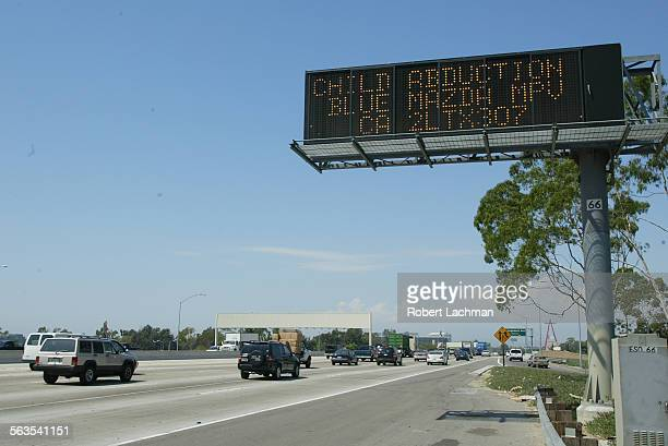 An Amber Alert for two missing girls is posted on a freeway sign along the 57 freeway in Orange