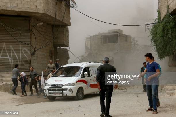 An ambluance launches to the site after Assad Regime's airstrike hit residential areas at the Saqba town of Eastern Ghouta in Damascus Syria on May 1...