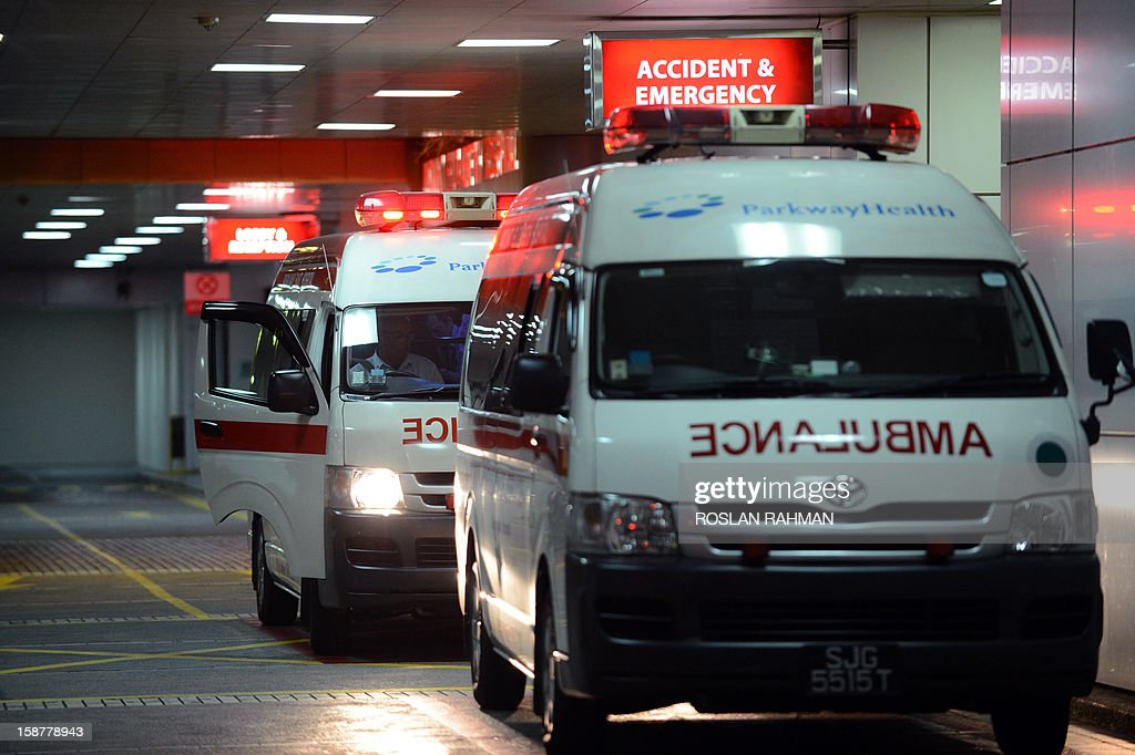 An ambulance (L) arrives outside the entrance of the Mount Elizabeth hospital in Singapore on early December 29, 2012. The medical condition of an Indian gang-rape victim has 'taken a turn for the worse' with 'signs of severe organ failure', the Singapore hospital treating her said in a statement issued late on December 28, 2012.
