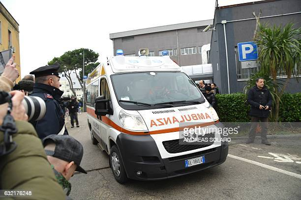 An ambulance arrives to the Pescara hospital in the coastal city of Pescara some 58 kilometer from the site of an avalanche that engulfed the Hotel...