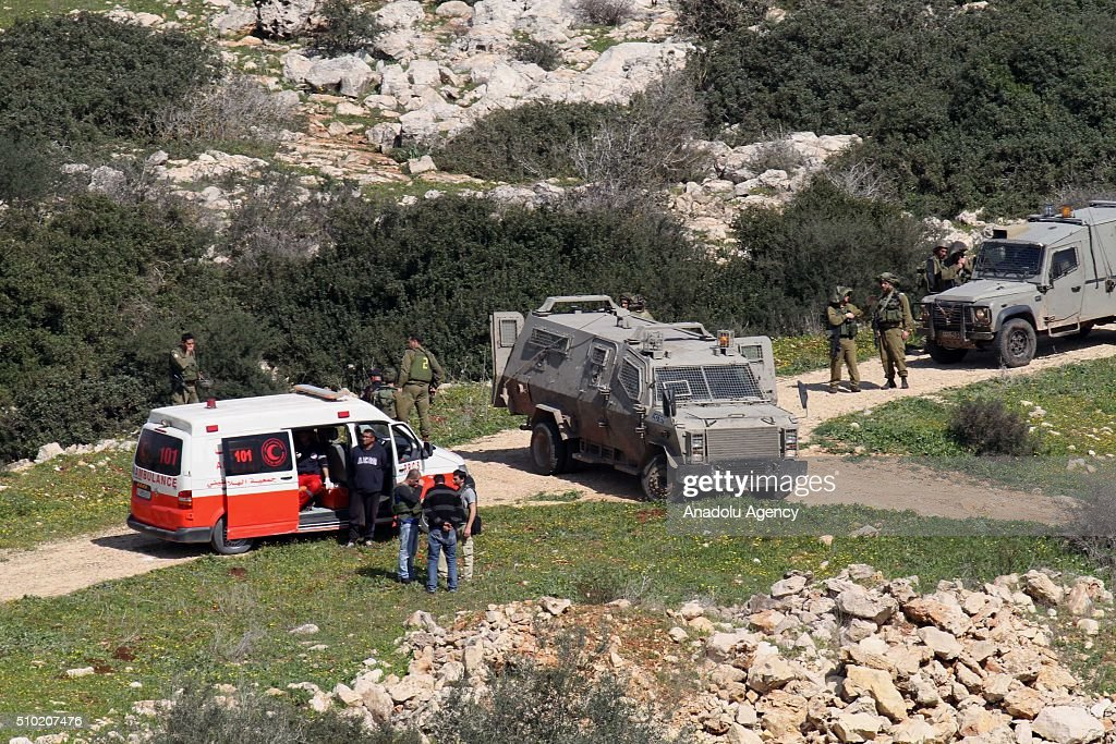 An ambulance belonging to Palestinian authorities waits to get the bodies of 2 15-year-old Palestinians, who have been killed by Israeli soldiers, in Jenin, West Bank on February 14, 2016.
