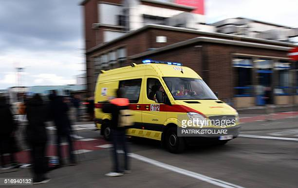 An ambulance car leaves Brussels Airport in Zaventem following twin blasts on March 22 2016 Bomb attacks at Brussels airport killed 14 people and...