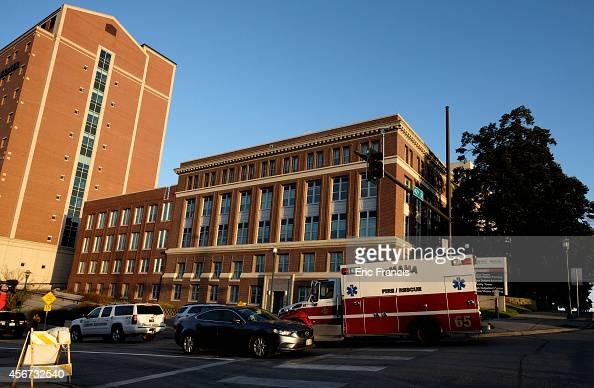 An ambulance carrying an American freelance cameraman who contracted Ebola in Liberia Ashoka Mukpo arrives at the Nebraska Medical Center October 6...