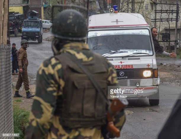 An ambulance carrying Kashmiri Muslim civilians who were wounded after Indian government forces fired on them after they tried to march towards gun...