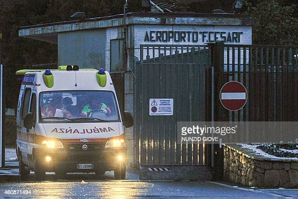 An ambulance carrying several injured passengers evacuated by helicopter from the burning ferry 'Norman Atlantic' adrift off Albania leaves the...