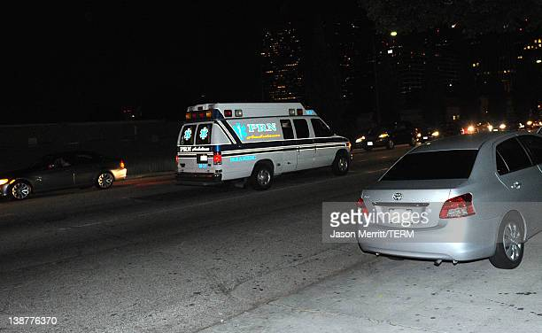 An ambulance departs from the Beverly Hilton Hotel before the Clive Davis and The Recording Academy's 2012 PreGRAMMY Gala And Salute To Industry...