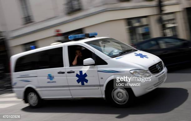 An ambulance drives down a street in Paris on April 17 2015 AFP PHOTO / LOIC VENANCE
