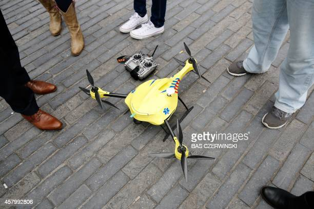 An ambulance drone with built in defibrillator is seen at the campus of the Delft Technical University in Delft on October 28 2014 The small aircraft...