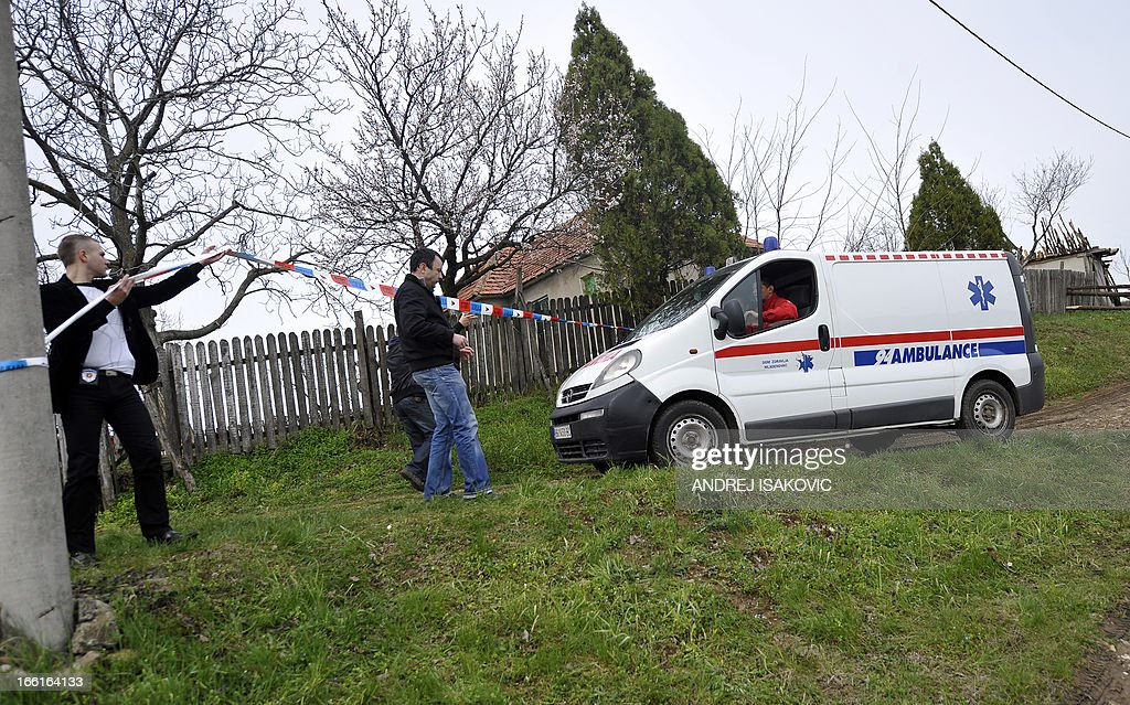 An ambulance goes to the site where a man shot dead 13 relatives and neighbours, including a two-year-old child in the village of Velika Ivanca, 40 kilometres south of capital Belgrade, on April 9, 2013.
