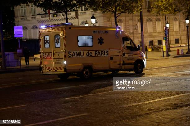 An ambulance is parked at the ChampsElysees The ChampsElysées avenue in Paris has been closed off by Police after an terror attack that cost the life...
