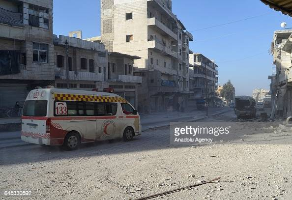 An ambulance is seen at the impact site after Assad Regime's airstrike over civilians in residential areas of Ariha town of Idlib Syria on February...