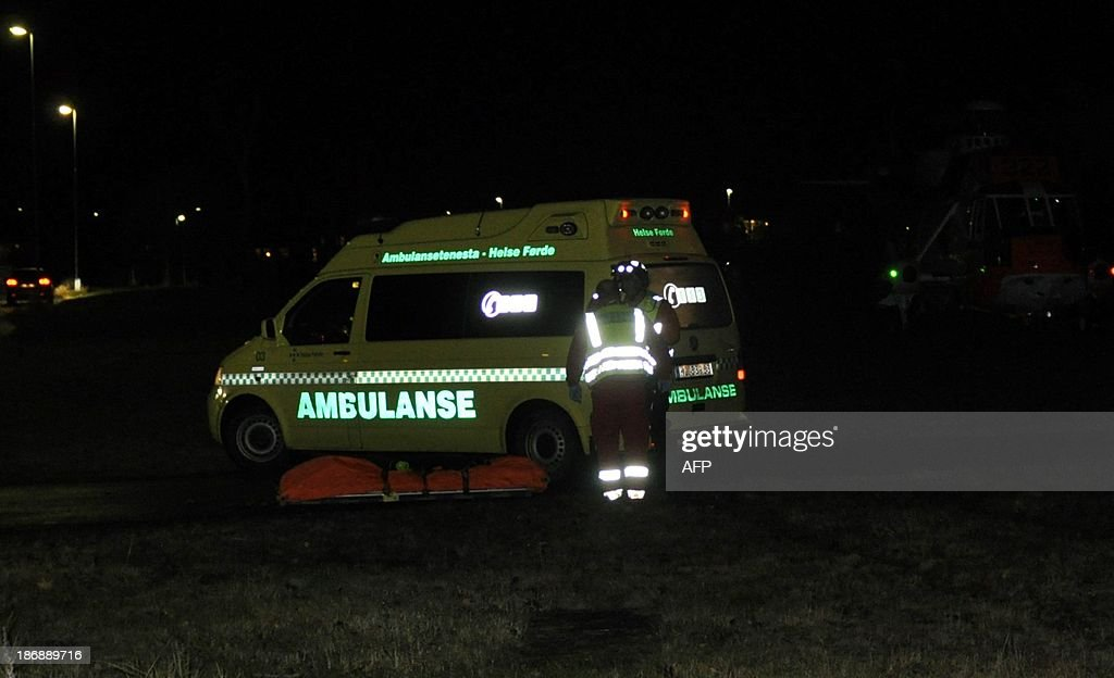 An ambulance is seen near the scene of a hijacked bus on November 4, 2013 in Aardal, western part of Norway. Three people were killed Monday when a man armed with a knife hijacked a bus in western Norway, local police said. AFP Photo /NTB scanpix / Mads Heggo /NORWAY OUT