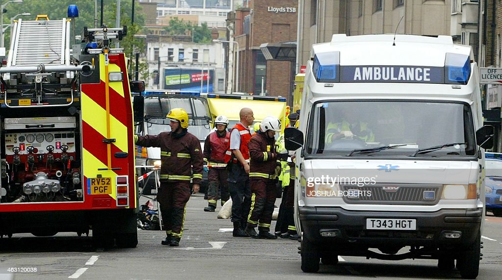 An ambulance leaves Aldgate Station after a series of explosions occurred throughout London, 07 July, 2005. Police said they believed at least two people had been killed in a series of six explosions which rocked central London buses and stations on Thursday.
