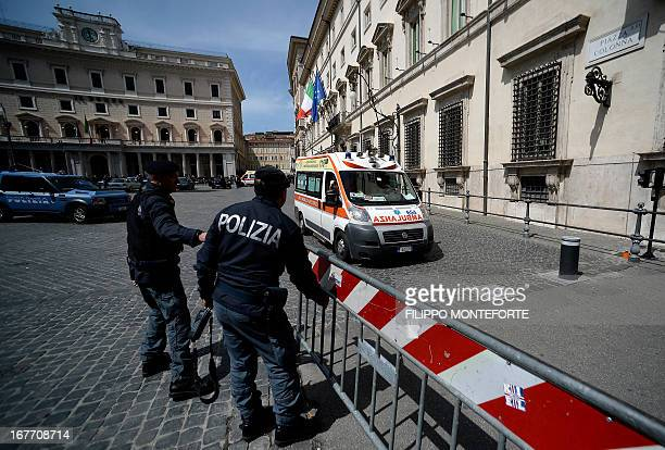 An ambulance leaves the area where a Carabiniere police officer was shot by an apparently disturbed man on April 28 2013 in Rome outside the palazzo...