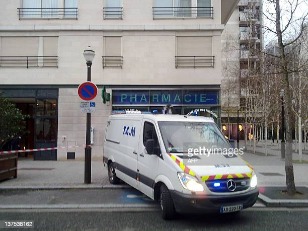 An ambulance leaves the building where French Education minister Luc Chatel's wife Astrid Herrenschmidt was found dead on January 22 2012 in...