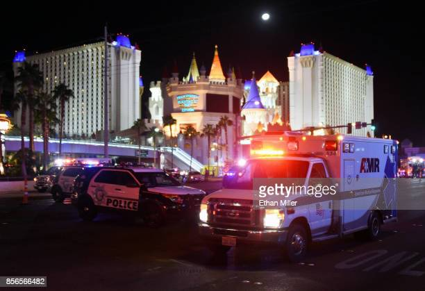 An ambulance leaves the intersection of Las Vegas Boulevard and Tropicana Ave after a mass shooting at a country music festival nearby on October 2...