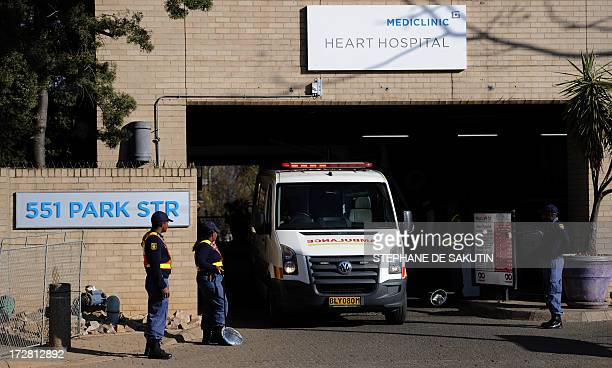 An Ambulance leaves the MediClinic Heart Hospital on July 4 2013 where former South African President Mandela is hospitalized in Pretoria During a...