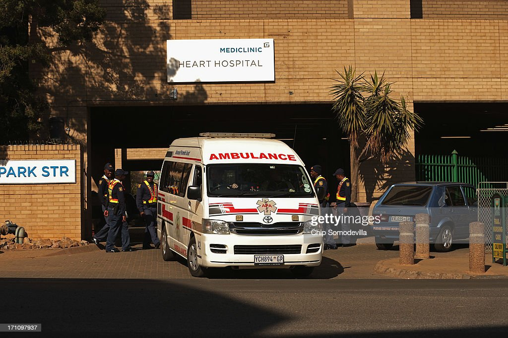 An ambulance leaves the Mediclinic Heart Hospital where former South African President Nelson Mandela, 94, is being treated for a recurring lung infection June 22, 2013 in Pretoria, South Africa. It was reported Saturday that the ambulance that transported Mandela to the hospital two weeks ago broke down for 40 minutes, delaying his arrival to the hospital by 40 minutes. The Nobel Peace Prize laurete and anti-aparteid icon has been in hospital for two weeks in 'serious but stable' condition, according to the South African government.