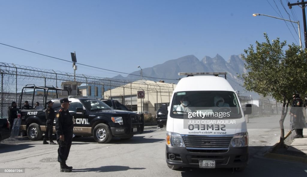 An ambulance of the forensic state service leaves the Topo Chico prison -where a riot took place- in Monterrey, Mexico on February 11, 2016. Riot police and ambulances were deployed at the Topo Chico prison as smoke billowed from the facility. At least 52 inmates were killed in a Mexican prison brawl on Thursday, as prisoners fought with bats, sticks and blades and ignited a fire in the overcrowded penitentiary. AFP PHOTO / JULIO CESAR AGUILAR / AFP / Julio Cesar Aguilar