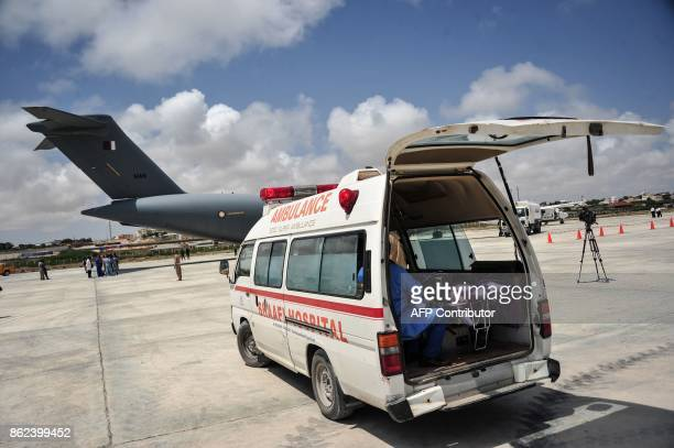 An ambulance parked on the tarmac carries a Somalian wounded by the latest truck bomb attack in Mogadishu before evacuating him by aircraft for...