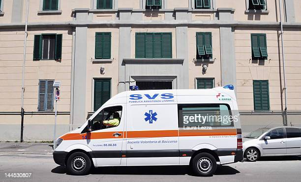 An ambulance passes in front of the building where Brigitte Skudlarek has allegedly murdered her husband Gabrio Gentilini on May 15 2012 in Livorno...