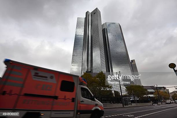 An ambulance passes the the headquarters of German bank Deutsche Bank on October 29 2015 in Frankfurt Germany Deutsche Bank announced at a press...