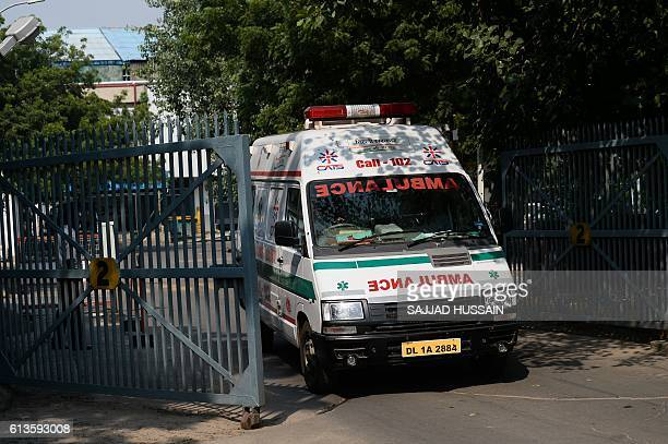 An ambulance present as a precuationary measure leaves a cargo area near the international terminal at New Delhi's international airport in New Delhi...
