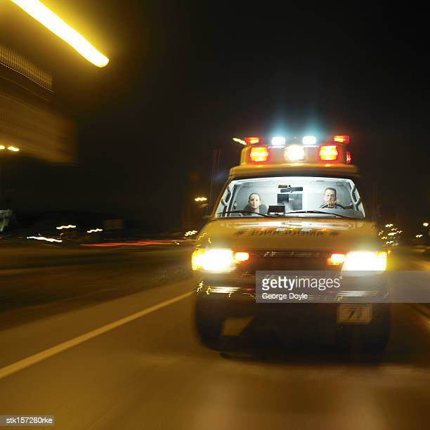 an ambulance rushing with its lights flashing