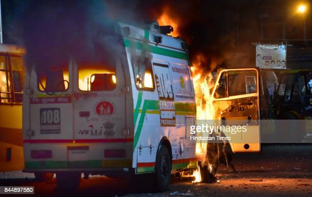 An ambulance set on fire by mob outside Ramganj Police Station during clashes between police and the mob on late Friday night as curfew was imposed...