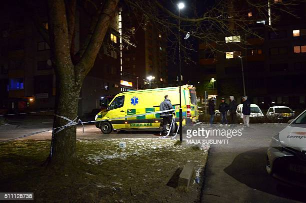 An ambulance stands in front of a Turkish cultural centre after an explosion on February 18 2016 in Fittja Sweden Police said no one had been injured...