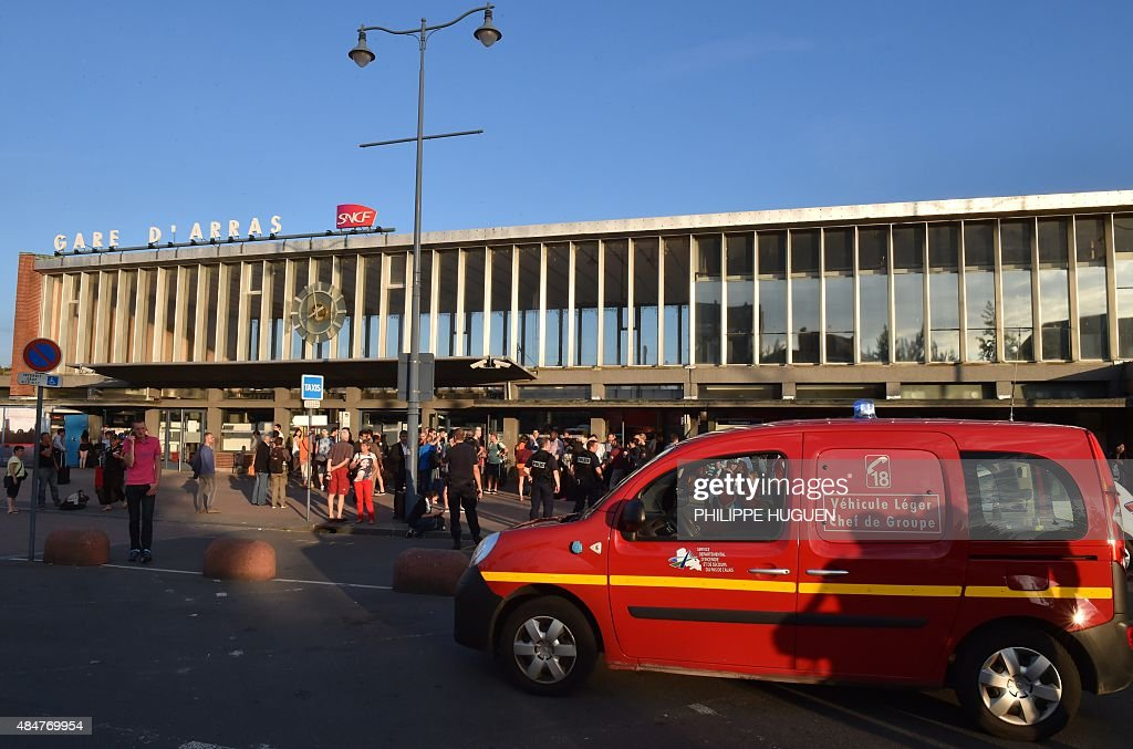 An ambulance stands outside the main train station in Arras northern France on August 21 2015 A gunman opened fire on a train travelling from...