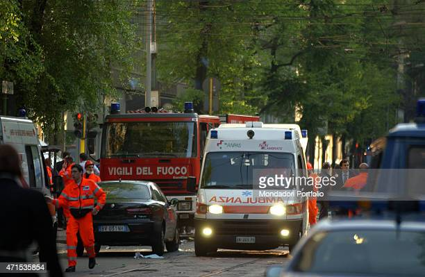 'An ambulance surrounded the firemen truck and the police cars crosses the street to bring aid to the victims of the Pirelli Tower's incident the...