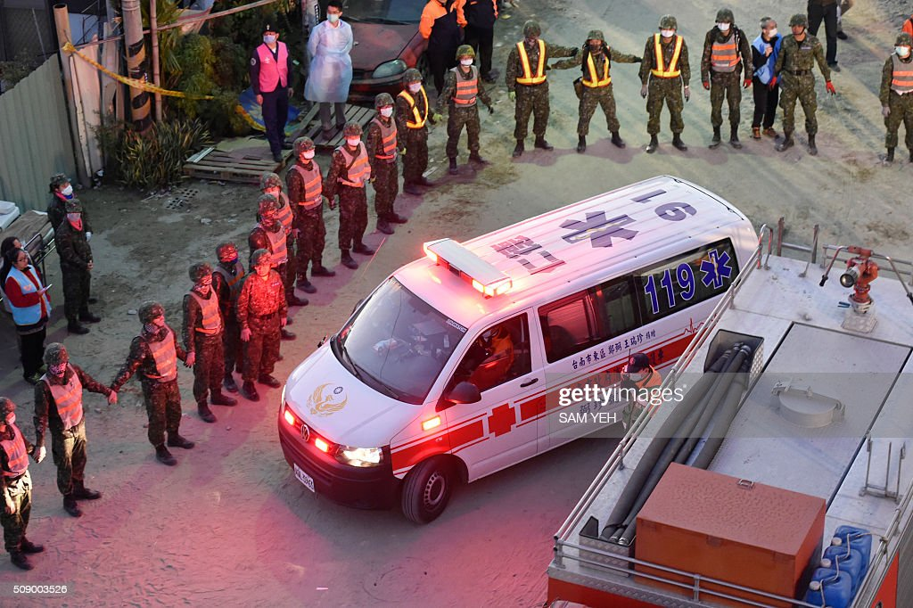An ambulance takes away a Vietnamese national, identified as 28-year old Chen Mei-Jih, to the hospital after she was extracted from the rubble at the Wei-Kuan complex which collapsed in the 6.4 magnitude earthquake, in the southern Taiwanese city of Tainan on February 8, 2016. Two survivors were on February 8 rescued from the rubble of an apartment complex in Taiwan felled by an earthquake, after being trapped for more than 50 hours. AFP PHOTO / Sam Yeh / AFP / SAM YEH